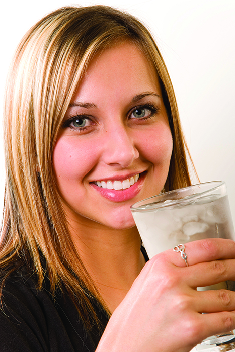 Woman drinking a glass of ice water