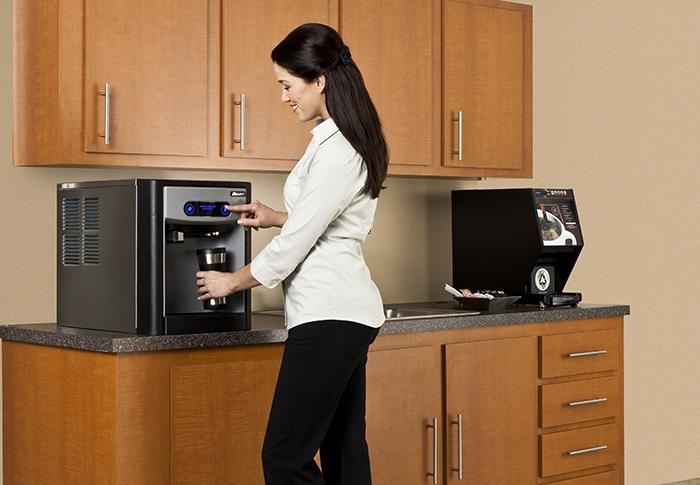 Woman dispensing ice and water in office break room